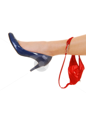 The leg of a girl with red thong. stock photo, One leg with a blue high heel and a red thong hanging on for white background. by Horst Petzold
