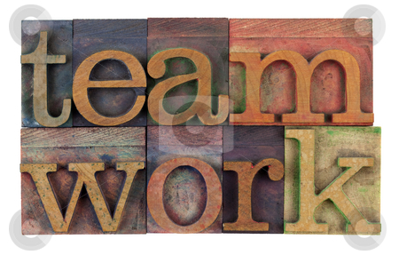 Teamwork in vintage letterpress type stock photo, The word teamwork in vintage wooden letterpress type, stained by colorful inks, isolated on white by Marek Uliasz