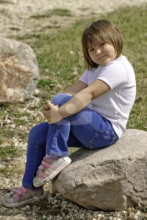 Cute Kindergarten Girl stock photo, A cute five year old girl posing on a rock outside by Richard Nelson