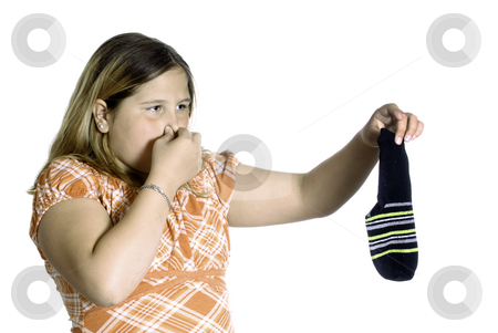 Smelly Sock stock photo, A young girl plugging her nose because of the smell of a stinky sock, isolated against a white background. by Richard Nelson