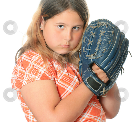 Baseball Catch stock photo, A closeup view of a preteen girl wearing casual clothing is playing catch with a ball and mitt, isolated against a white background. by Richard Nelson