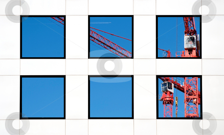 Office block stock photo, Six windows in a white office block reflecting a crane by Paul Phillips