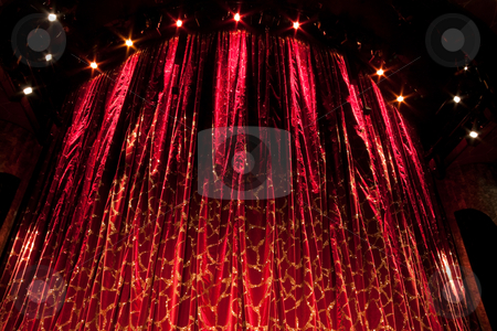 Red Curtain stock photo, A velvet red theater curtain with traces of gold by Kevin Tietz