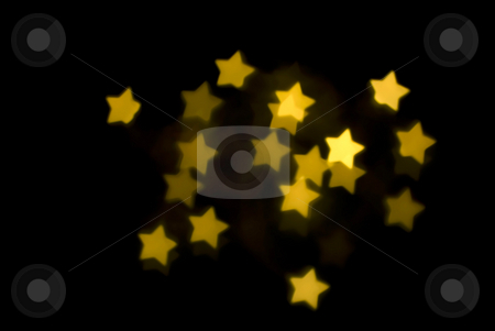 Gold stars stock photo, A background image of yellow gold bokeh stars by Stephen Gibson