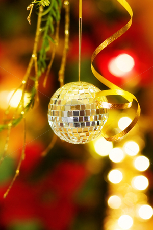 Christmas disco ball decoration stock photo, Celebrating the magic of Christmas with disco ball and golden lights decorated tree. by Andreea Chiper