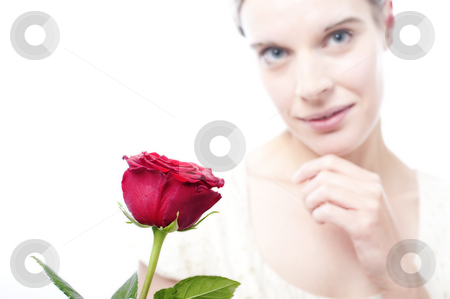 Yound woman with rose stock photo, Young woman with red rose, copy space, white background by Kai Schirmer