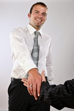 Good Deal stock photo, Young corporate Man Shaking Hands Greeting A Good Deal by Nick Fingerhut