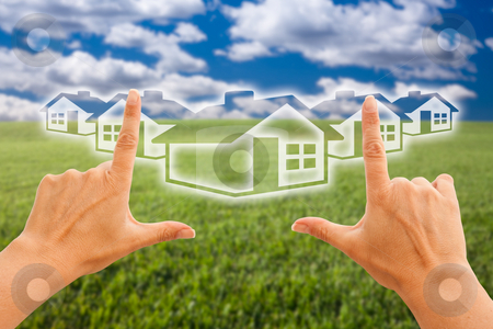 Female Hands Framing Houses Over Grass and Sky stock photo, Female Hands Framing Houses Over Grass Field and Sky by Andy Dean
