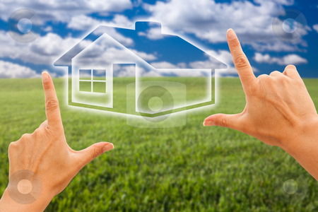 Female Hands Framing House Over Grass and Sky stock photo, Female Hands Framing House Over Grass Field and Sky by Andy Dean