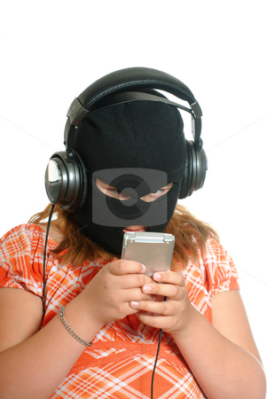 Music Piracy stock photo, Concept image of a young girl listening to pirated or illegal music downloads on her mp3 player, isolated against a white background. by Richard Nelson