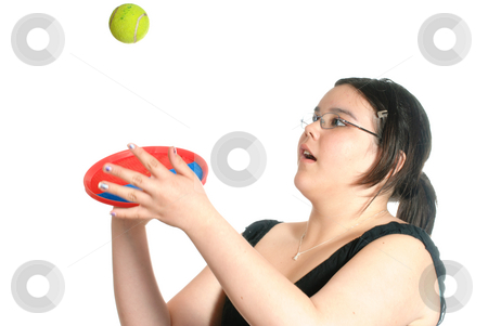 Catch stock photo, Young preteen girl playing catch with a Hook and Loop Fastener mitt and ball, isolated against a white background. by Richard Nelson
