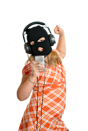 Illegal MP3 Downloads stock photo, Concept image of a young girl dancing to pirated or illegal music downloads on her mp3 player, isolated against a white background. by Richard Nelson
