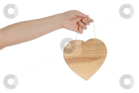 Love stock photo, Closeup view of a child's hand holding a wooden heart, isolated against a white background. by Richard Nelson