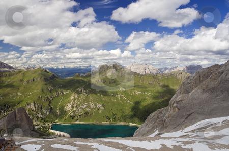 Panorama from Marmolada glacier stock photo, Summer view of Fedaia lake and dolomites from Marmolada glacier, Trentino, Italy. Photo taken with polarizer filter by ANTONIO SCARPI