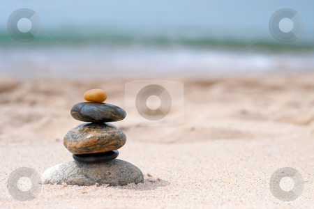 Balanced Zen Rocks stock photo, A pile of round smooth zen rocks stacked and balancing in the sand at the beach. by Todd Arena
