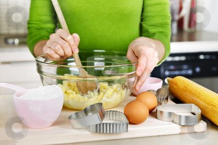 Mixing ingredients for cookies stock photo, Mixing ingredients for baking cookies in glass bowl by Elena Elisseeva
