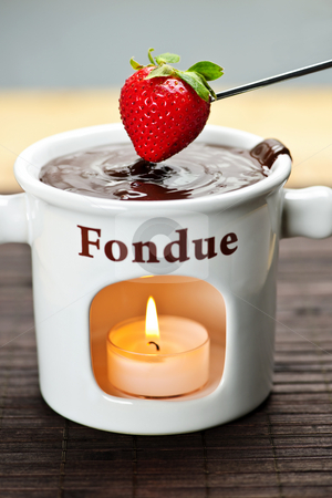 Strawberry dipped in chocolate fondue stock photo, Strawberry dipped in delicious melted chocolate fondue by Elena Elisseeva