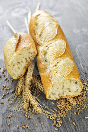 White baguette stock photo, Freshly baked white baguette with wheat ears and grain by Elena Elisseeva
