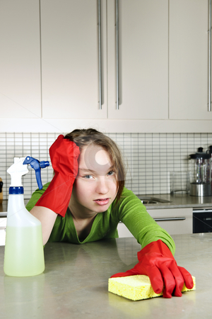 Tired girl cleaning kitchen stock photo, Tired girl doing kitchen cleaning chores with rubber gloves by Elena Elisseeva