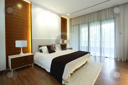 Modern bedroom stock photo, Interior view of a modern bedroom by Adrin Shamsudin