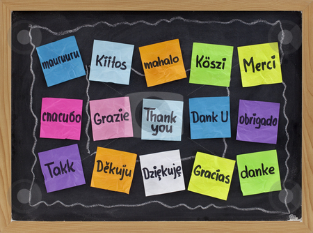 Thank you in different languages stock photo, Thank you in sixteen languages - colorful sticky notes on blackboard with white chalk smudges by Marek Uliasz