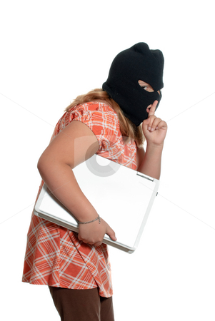 Child Stealing Laptop stock photo, A young girl is stealing a laptop, isolated against a white background. by Richard Nelson