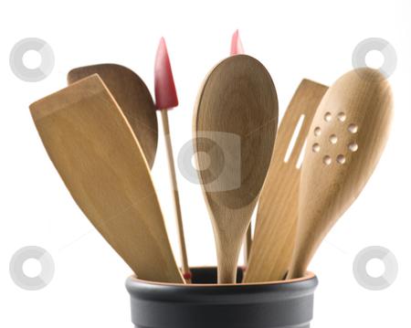 Kitchen Utensils stock photo, Wooden Kitchen Utensils In A Black Jar Against A White Background by Karen Appleyard