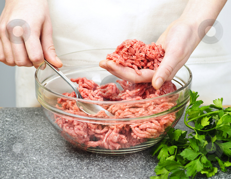 Cooking with ground beef stock photo, Chef cooking in kitchen with ground beef by Elena Elisseeva