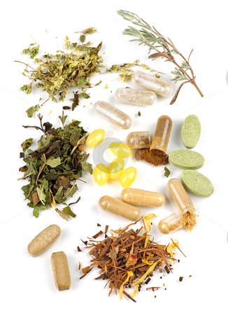 Herbal supplement pills stock photo, Herbs,  herbal supplements and vitamin pills on white background by Elena Elisseeva