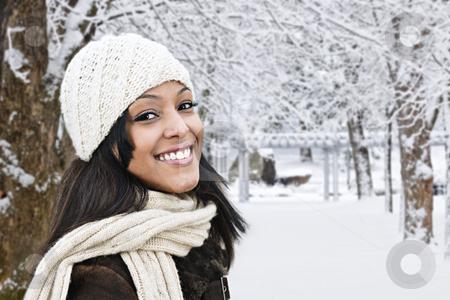 Happy woman outside in winter stock photo, Portrait of happy woman outdoors in winter by Elena Elisseeva