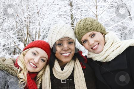 Group of girl friends outside in winter stock photo, Group of three diverse young girl friends outdoors in winter by Elena Elisseeva
