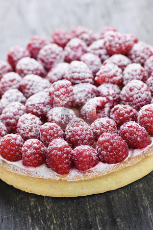 Raspberry tart stock photo, Fresh dessert fruit tart covered in raspberries by Elena Elisseeva