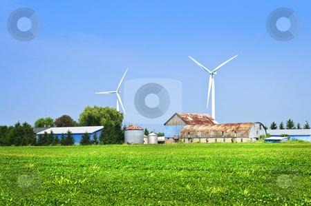 Wind turbines on farm stock photo, Green alternative clean power wind turbines on farm by Elena Elisseeva