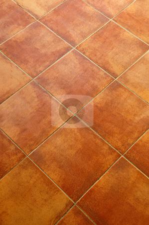 Tiled floor stock photo, Closeup of square terracotta ceramic tile floor background by Elena Elisseeva