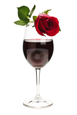 Wine with red rose stock photo, Romantic  rose on top of  red wine glass isolated on white background by Elena Elisseeva
