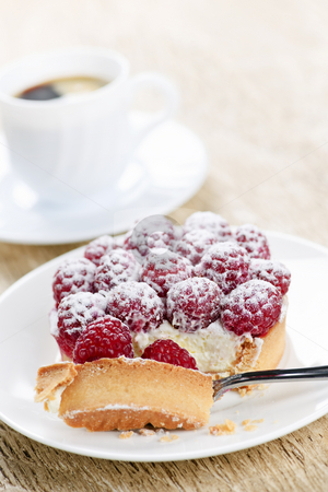 Raspberry tart with coffee stock photo, Fresh raspberry tart served with coffee for dessert by Elena Elisseeva