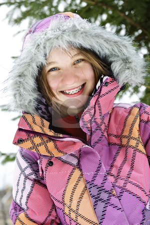 Happy winter girl in ski jacket stock photo, Portrait of happy teenage girl in winter ski coat with fur hood by Elena Elisseeva