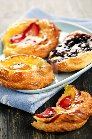 Plate of fruit danishes stock photo, Closeup of fruit danish desserts on a plate by Elena Elisseeva