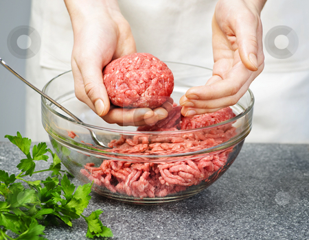 Cooking with ground beef stock photo, Chef making hamburgers in kitchen with ground beef by Elena Elisseeva