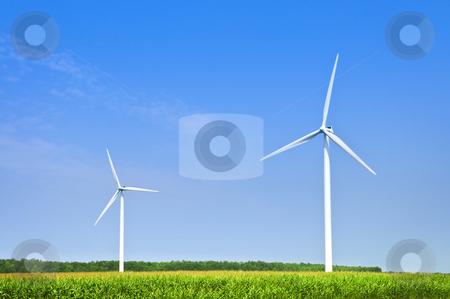 Wind turbines in field stock photo, Green alternative clean power wind turbines in field by Elena Elisseeva