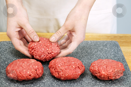 Cooking with ground beef stock photo, Chef making hamburger patties in kitchen with ground beef by Elena Elisseeva