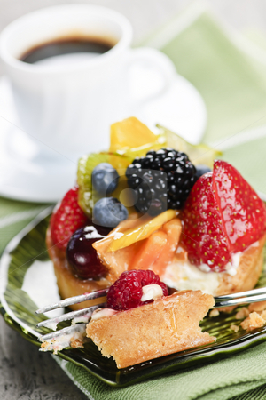 Assorted berry tart with coffee stock photo, Fresh mixed berry tart served with coffee for dessert by Elena Elisseeva