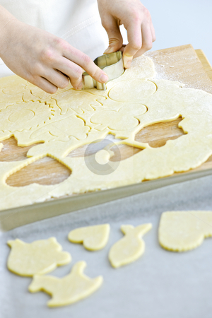 Cutting cookies from dough stock photo, Woman using cookie cutter and baking homemade cookies by Elena Elisseeva