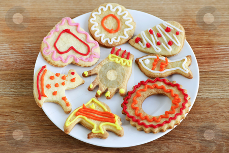 Plate of homemade cookies stock photo, Homemade shortbread cookies with icing on a plate by Elena Elisseeva