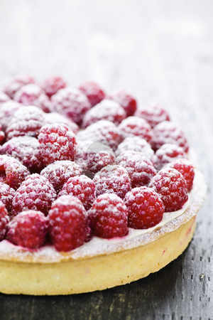 Raspberry tart stock photo, Fresh dessert fruit tart covered in raspberries by Elena Elisseeva