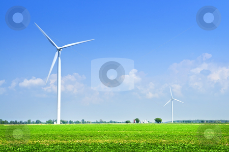 Wind turbines in field stock photo, Green alternative clean power wind turbines in field by Elena Elisseeva