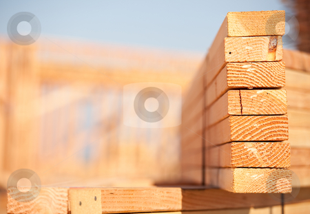 Stack of Building Lumber stock photo, Stack of Building Lumber at Construction Site with Narrow Depth of Field. by Andy Dean