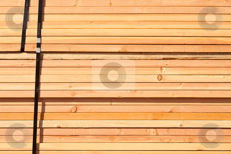 Stack of Building Lumber stock photo, Stack of Building Lumber at Construction Site. by Andy Dean