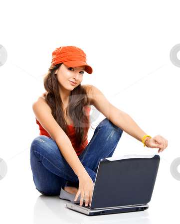 Teenager working with a laptop stock photo, Beautiful young female student with a laptop, isolated on white by ikostudio