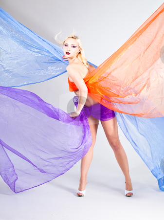 Beautiful young woman wraped in colorful tulle stock photo, Beautiful young woman wraped in colorful tulle as bikini, vertical shot by Ruta Balciunaite
